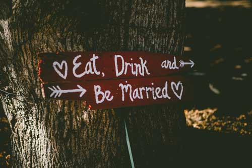 Eat, drink, be married sign on a tree.